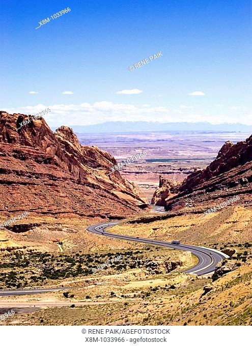 I-70 bisects the San Rafael Swell, and at Spotted Wolf Canyon, construction workers could stand and simultaneously touch both canyon walls with their hands...