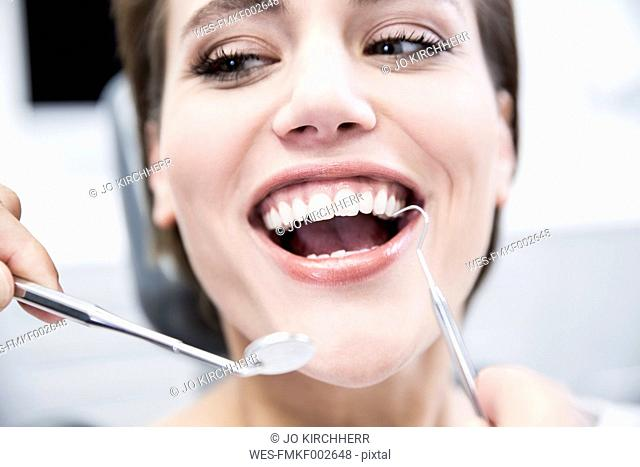 Young woman at the dentist receiving treatment