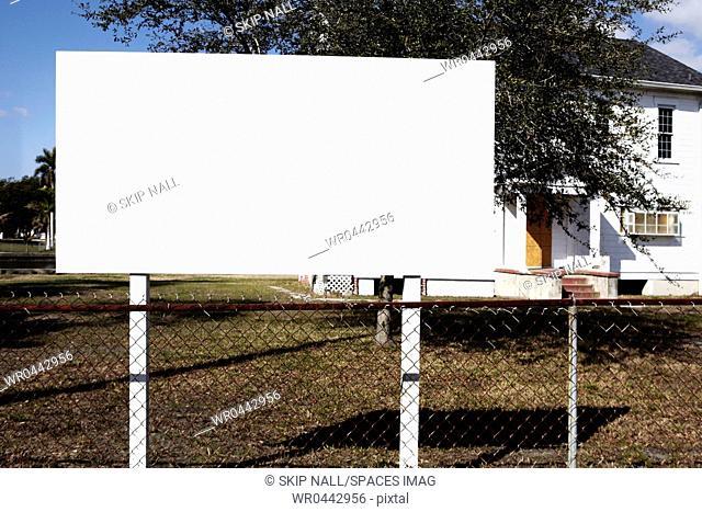Blank Billboard on a Lawn