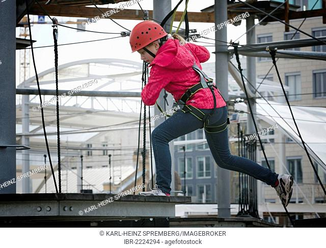 10-year-old girl climbing in a high rope course, Berlin, Germany, Europe