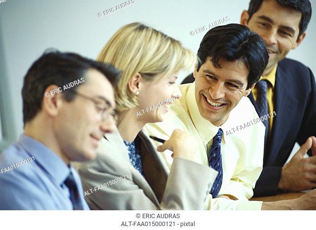 Business executives sitting together, laughing