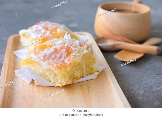 Sweet butter bread topping with butter and sugar on wood tray