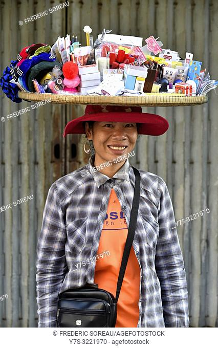 Woman carrying a basket on her head in Phnom Penh,Cambodia,South east Asia