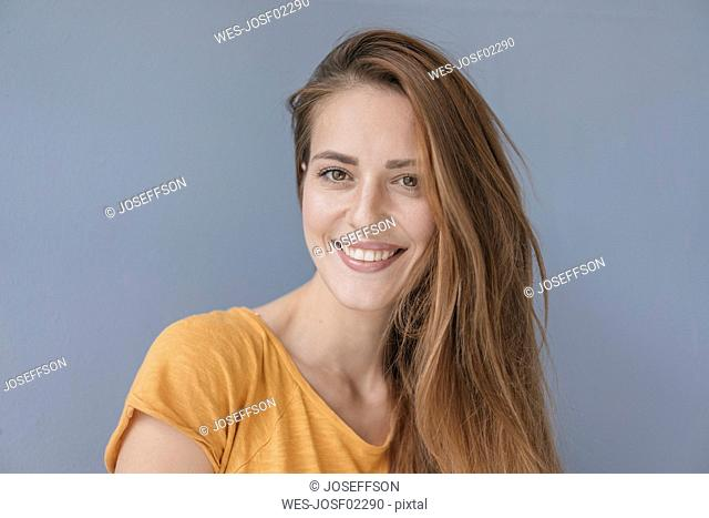 Portrait of a pretty woman, smiling, looking at camera