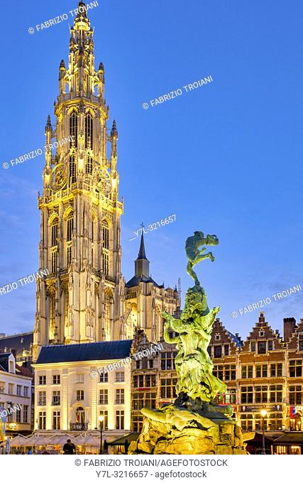 "The Brabo fountain in the Grote Markt (""Great Market Square"") with the belfry of the Cathedral of Our Lady in the background of Antwerp, Belgium"