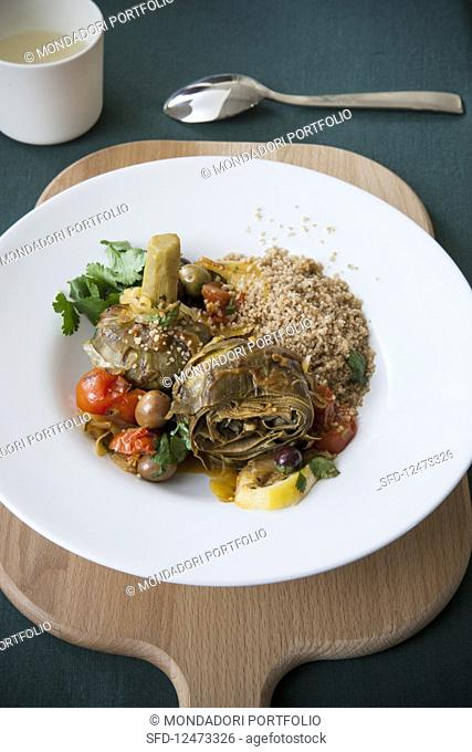 Artichoke tagine with lemon and tomatoes on wholegrain couscous