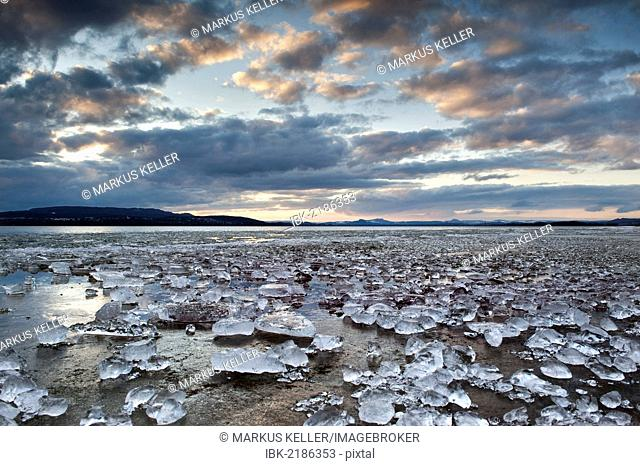 Chunks of ice lying on icy surface on the shore of Reichenau Island, Baden-Wuerttemberg, Germany, Europe