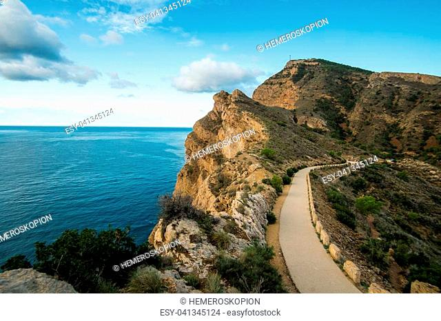 Sierra Helada cliffs and scenic road to its lighthouse overlooking Altea bay, Costa Blanca, Spain