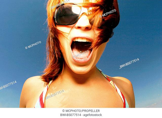 crying redheaded girl with tongue piercing