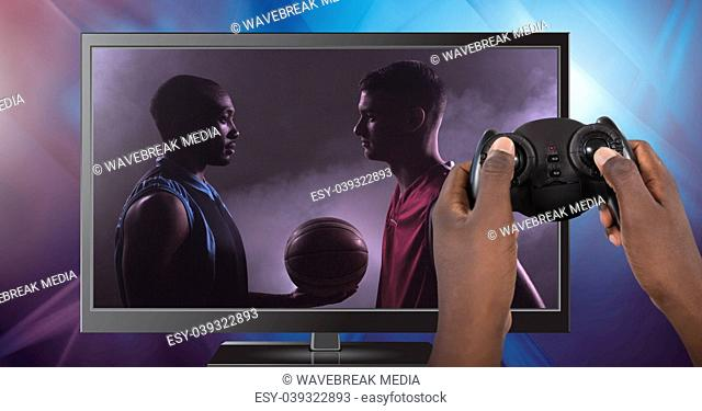 Hands holding gaming controller with soccer player on television