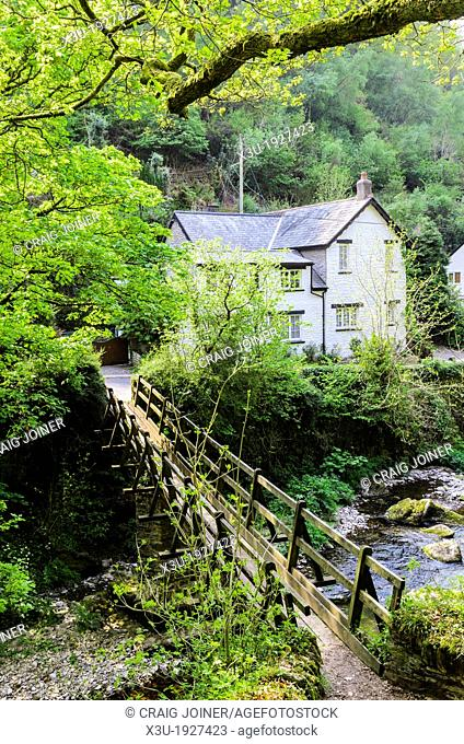 Footbridge over the East Lyn River at Rockford in Exmoor during spring near Lynmouth, Devon, England