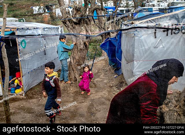 27 February 2020, Greece, Lesbos: Children play in a temporary tent camp near the camp for migrants in Moria. Following serious clashes between police and angry...