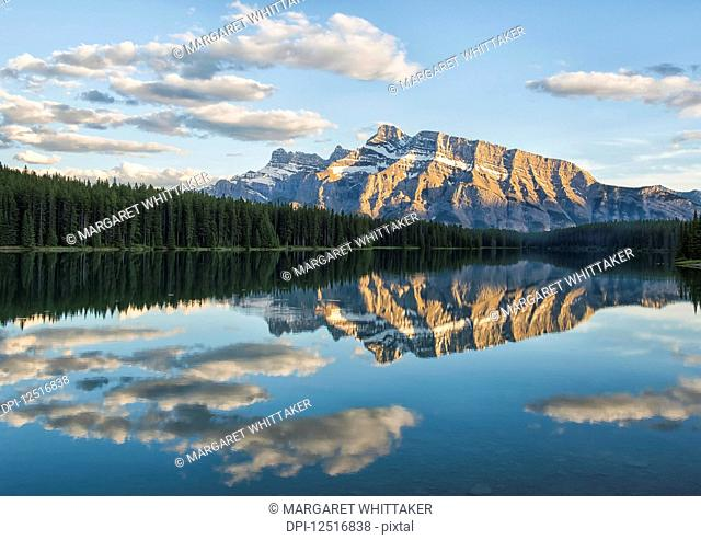 View of the back of Mount Rundle reflected in the water of Two Jack Lake, Banff National Park; Banff, Alberta, Canada