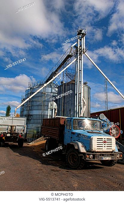 Lithuania improvements industry farming with colorful company of wheat farming storage area with trucks in Vaunas Lithuania - 01/10/2015