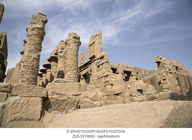 Inner view of a temple and carved pillars of the great hypostyle hall in the Precinct of Amon Re, Situated at Karnak Temple complex