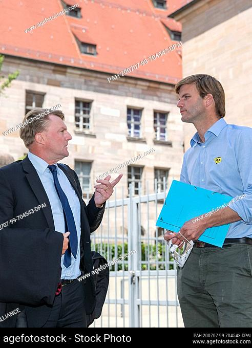 07 July 2020, Bavaria, Nuremberg: Hubertus Freiherr von Crailsheim (r) talks to his lawyer Ralf Bornhorst in front of the building of the Nuremberg-Fürth...