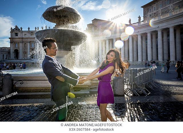 Couple at Piazza San Pietro with fountain. Rome. Italy