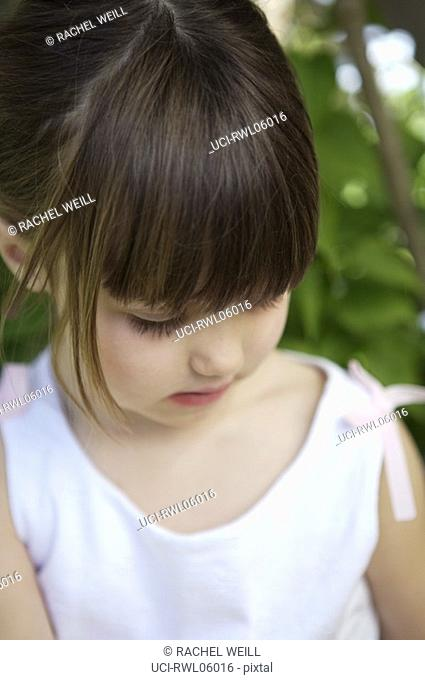 Close up of girl looking down