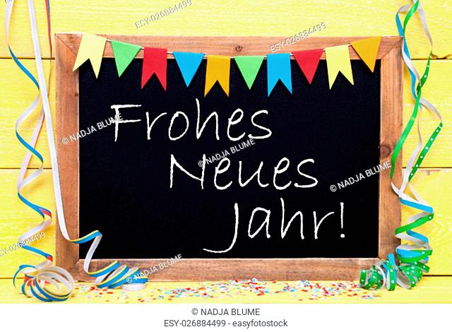 Chalkboard With German Text Frohes Neues Jahr Means Happy New Year. Party Decoration Like Streamer, Confetti And Bunting Flags