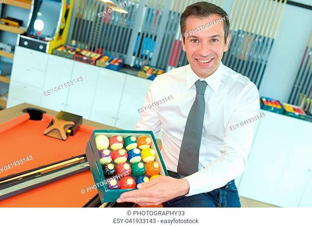 professional billiard player showing billiard balls