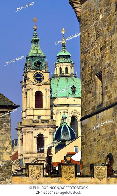 Prague, Czech Republic. Charles Bridge (Karluv most) Bridge tower and the dome of St Nicholas' Church (Mala strana)
