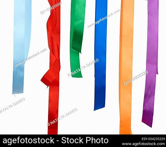 multicolored silk ribbons isolated on white background, decor hangs