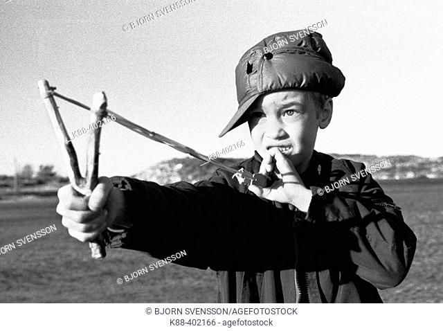 Young boy with slingshot, Sweden