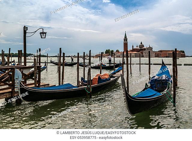Rainy day on a gondola pier in Venice Italy