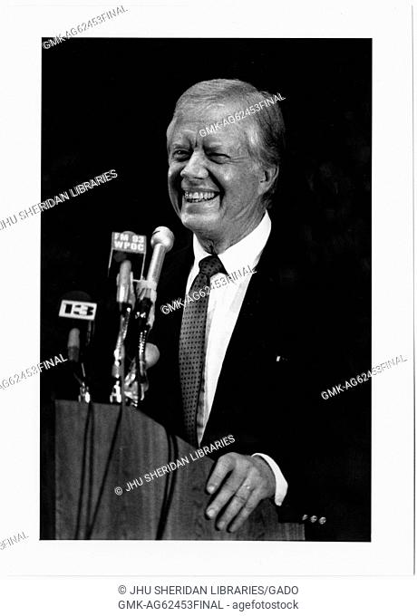 Candid photograph of former President James Earl Carter, Jr at a press conference after receiving the Albert Schweitzer award for Humanitarianism, 1987