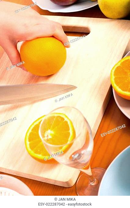 Cutting healthy fresh orange