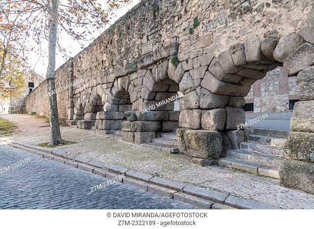 Initial section of the Roman aqueduct, Casa del Agua (Waterhouse) in background. Segovia. Castile-Leon, Spain