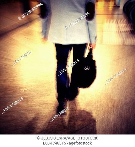Man walking in RENFE station, Madrid, Spain