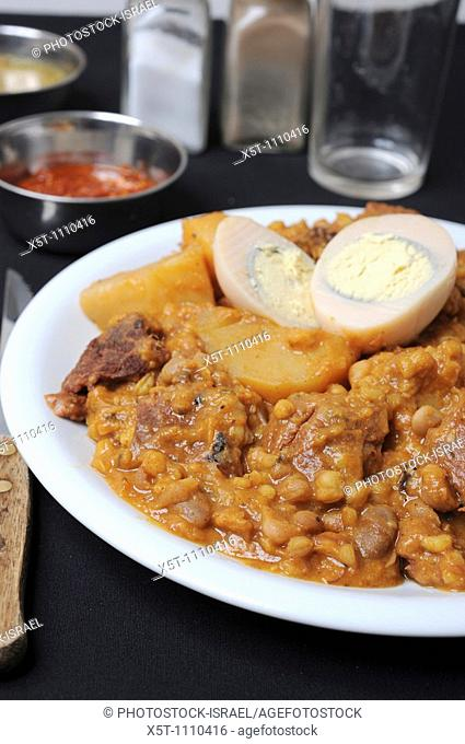 Cholent or hamin is a traditional Jewish stew simmered overnight, for 12 hours or more, and eaten for lunch on the Sabbath