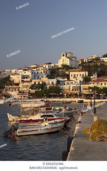 Batsi, port, fishing boats, church  Andros, Cyclades, Greece