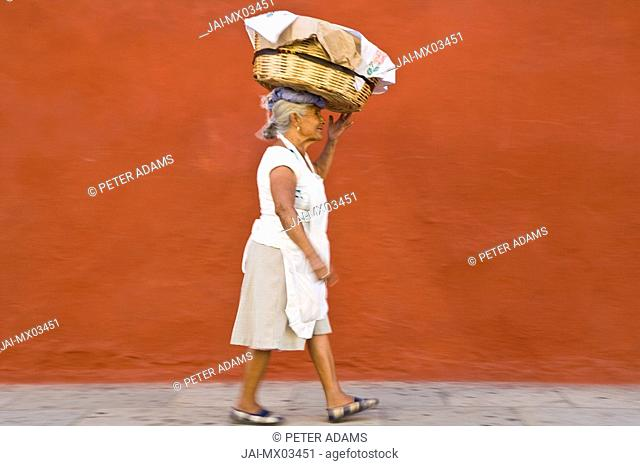 Street vendor with basket on head, Oaxaca, Oaxaca State, Mexico