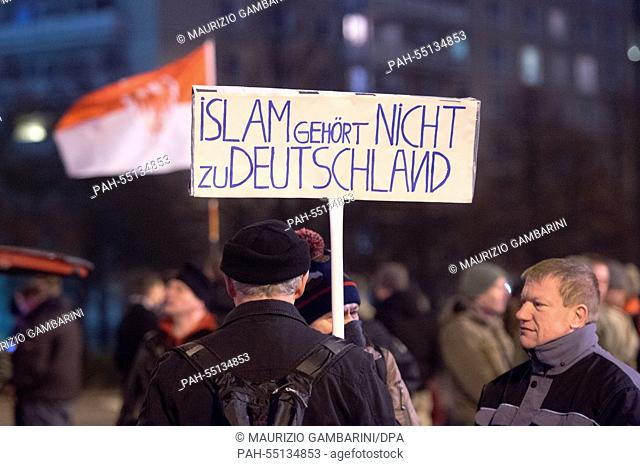 Members of the Islam-critical Bargida movement (Berliner Patriots against the Islamization of the West) demonstrate with a sign that reads 'Islam does not...