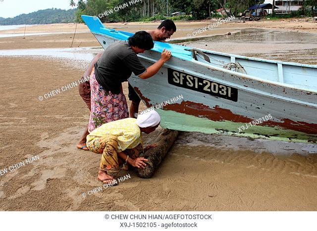 Fishermen with a boat, Teluk Melano, Sarawak, Borneo