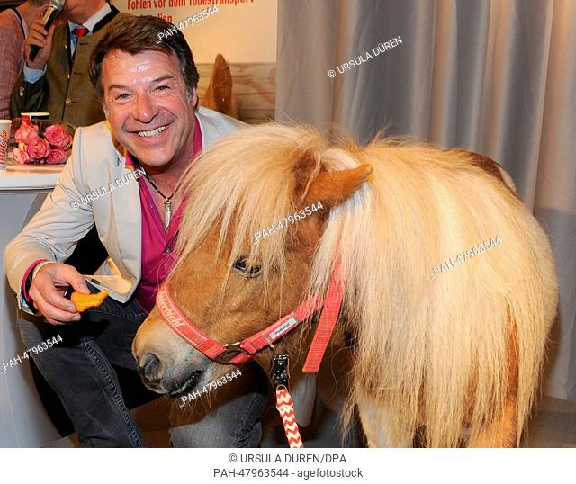 German singer Patrick Lindner poses with former circus pony 'Pumuckl' to promote the Gut Aiderbichl farm in a shopping center inMunich, Germany, 17 April 2014