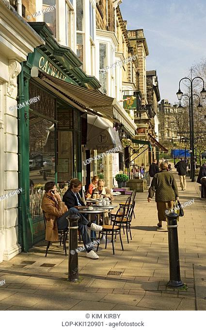 England, North Yorkshire, Harrogate, People sitting outside a cafe enjoying the spring sunshine on Montpellier Parade