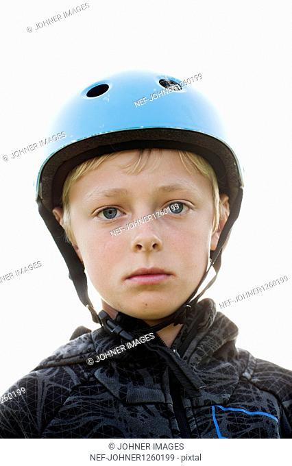 Portrait of boy wearing sports helmet