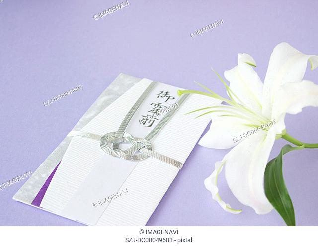 Lily and a condolence-money envelop Mourning image