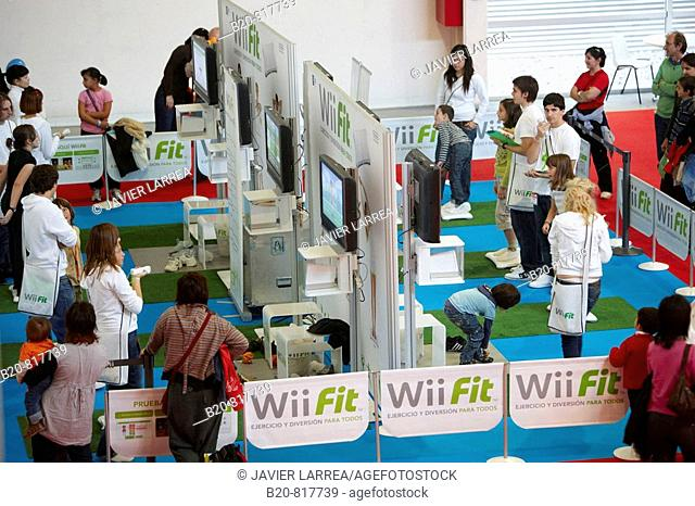 Visitors in a video game stand, Wii Fit, Mendiexpo fair, FICOBA, Irun, Guipuzcoa, Basque Country, Spain