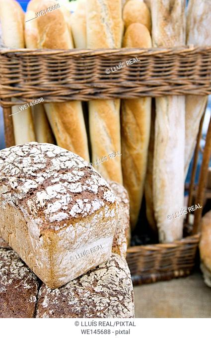 wicker basket on a bakery with loaves of bread and organic bread mold