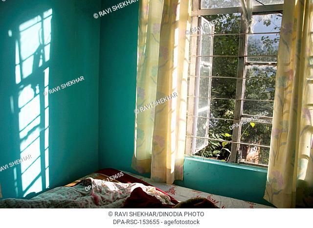 Winter morning light coming from the window in hotel room ; Mcleod Ganj ; Himachal Pradesh ; India