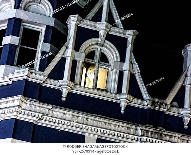 There's a light in the attic of an old Victorian building. Cape Town, South Africa