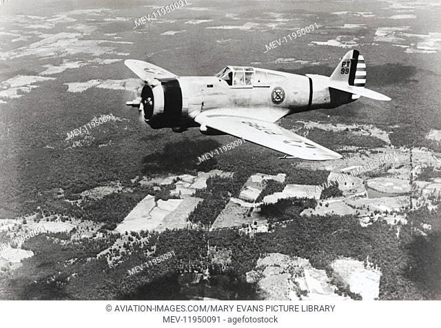 A USAF Curtiss P-36 Hawk Flying over Trees
