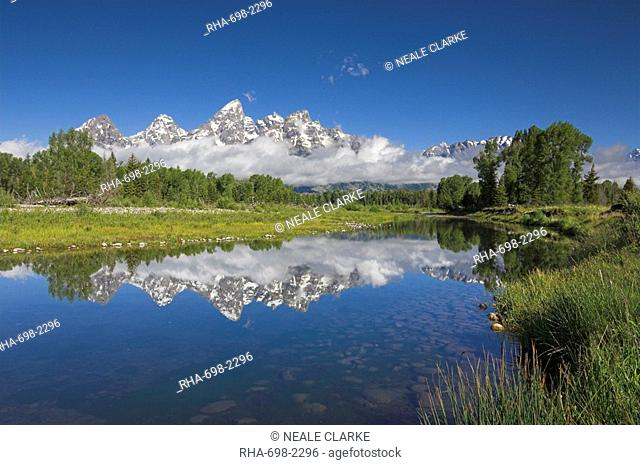 The Cathedral Group of Mount Teewinot, Mount Owen and Grand Teton reflected in the Snake River, Schwabacher's Landing, Grand Teton National Park, Wyoming