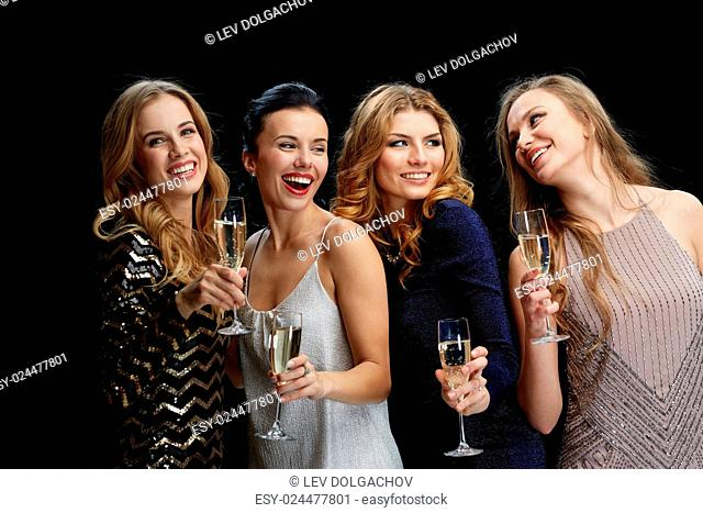 celebration, friends, bachelorette party and holidays concept - happy women with champagne glasses over black background