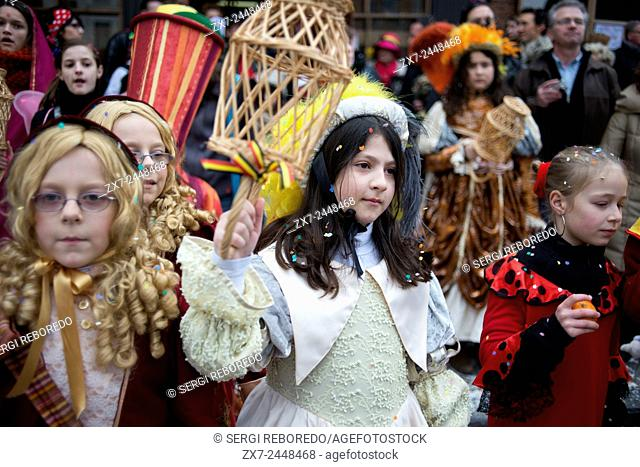 Children and teenagers dressed with costumes. Music, dance, party and costumes in Binche Carnival. Ancient and representative cultural event of Wallonia