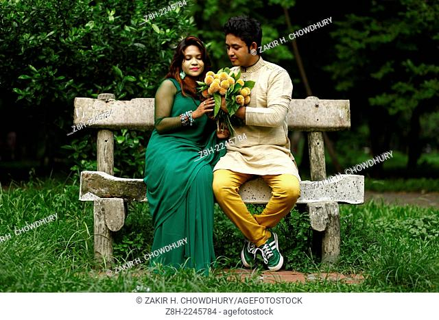 a couple present their love with kadam flowers